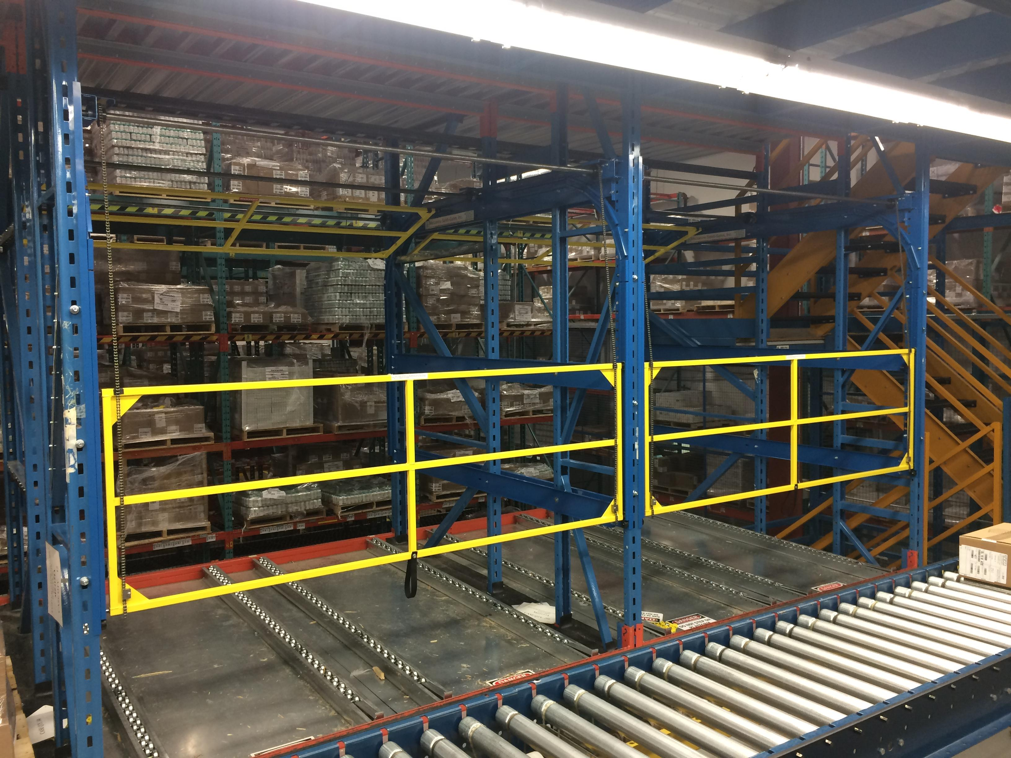 Safety gates for pallet flow lanes
